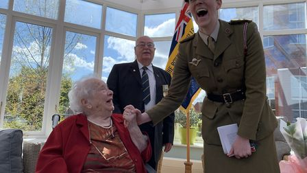 Commander Alex Milne of the FANYs shares a laugh with Dorothy Mann, at the presentation of her Légio