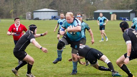 Jono Cooke on the rampage for Woodbridge during their 17-7 defeat against Holt Picture: SIMON BALLA
