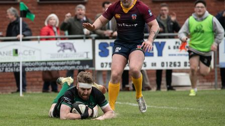 Roydon Miller goes over for North Walsham during their final home match of the season in London 1N P