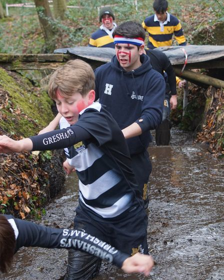 Students from Gresham's School in Holt take part in a 'Gritty Grasshopper' run to raise money for t
