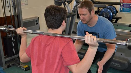 Fit for the future – Working out in the health hut gym under guidance from instructor and youth work