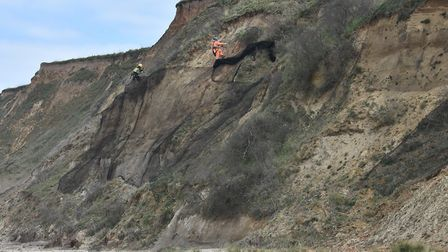 Netting being removed from the cliffs at Bacton in north Norfolk. The netting was having a negative