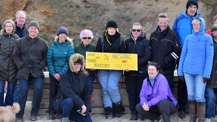Protesters at Bacton over the cliff netting which has been stopping sand martins from nesting. PICTU