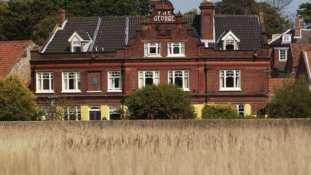 The George Hotel, at Cley, as seen from the marshes. The hotel's owner, Steven Cleeve, has opted to