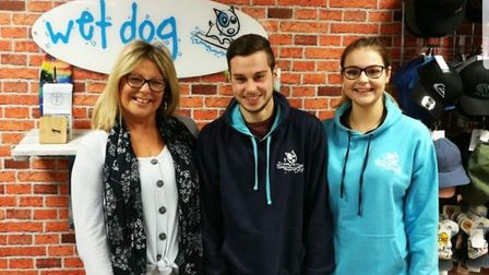 Adam and Rebekah Masters with Wet Dog surf shop owner Kay Weston, who is sponsoring their trek up Mo