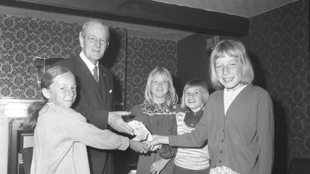 North Walsham Primary School children present £10 to old folk, June 1975. Photo: Archant Library