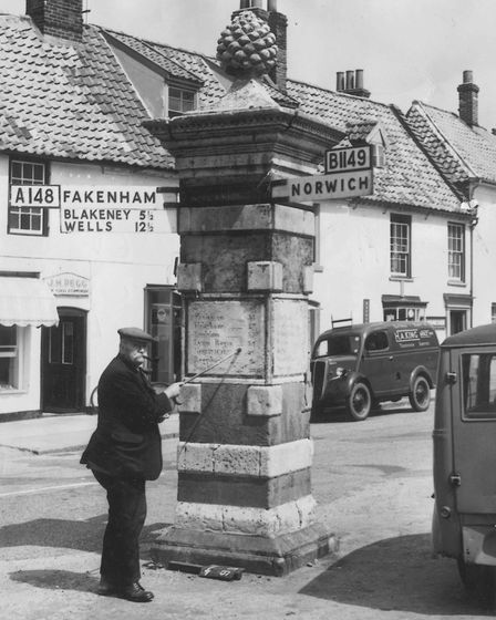 Monument on Obelisk Plain road sign at Holt, 17 May 1956 . Photo: Archant Library