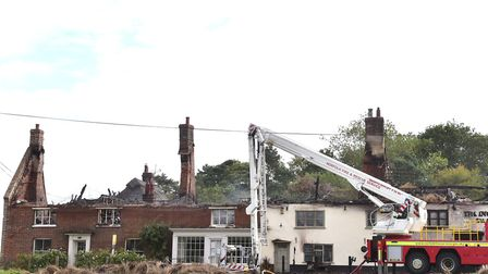 The Town House, on the left, and the Ingham Swan at the time of the blaze. Picture: Nick Butcher