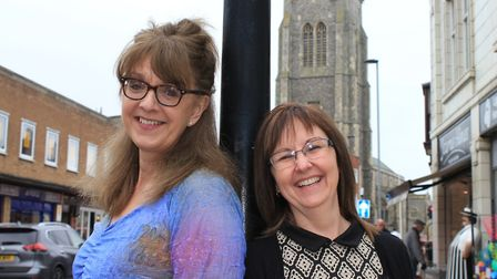 Cromer traders Jayne Bowyer and Alison Ewbank try their flower power outfits for size, ready for the