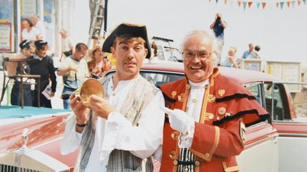 Cromer town crier Jason Bell on the pier forecourt with TV star Bradley Walsh.Photo: ARCHANT