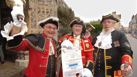 Jason Bell (left) announcing the 2004 European Town Crier Competition with fellow criers Tony Evans
