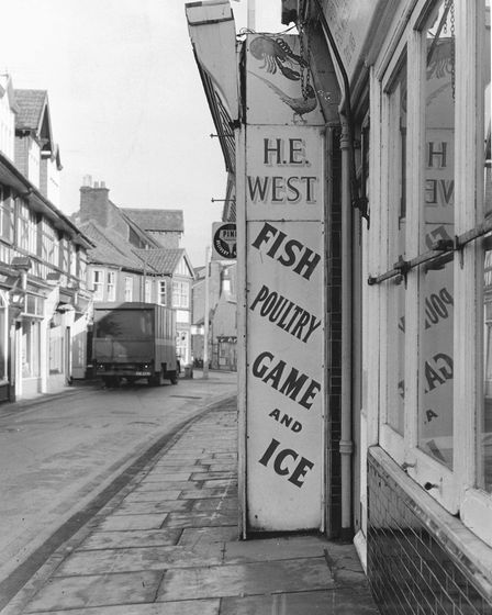 Places - SMr. H.E. West's shop sign at Sheringham.Dated 21 January 1969Photograph C7923