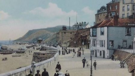 An historic postcard showing the Bath House with a blueish hue on Cromer's promenade. Image: PLANNIN