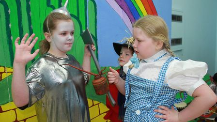 Daisy, 9, as the Tin Man and Iris, 8, as Dorothy in Cromer Junior School's Year 4 production of the