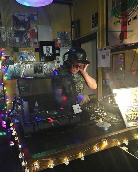 Paul Wellings in Holt. Also known as DJ Madhatter, Mr Wellings is getting ready for a gig at Cromer