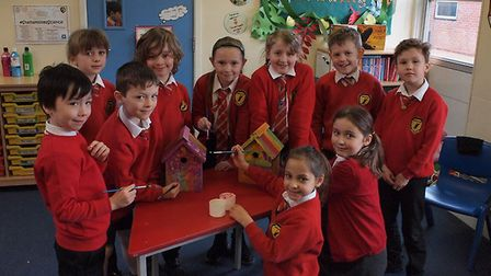 Stalham Academy School Year 3 pupils colourfully painting with their own ideas the donated bird nest