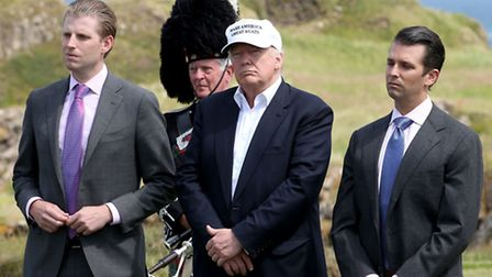 Donald Trump, with his sons Eric (left) and Donald Trump Jr