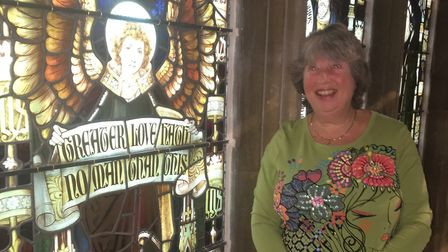 Gill Cartwright by the refitted stained glass window at St Nicholas Church, North Walsham. Pictures: