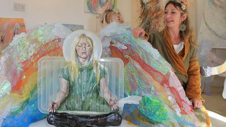 Artist Hannah Hardy with her sculpture created from household plastics.Picture: KAREN BETHELL