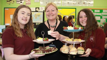 Sheringham High School food and nutrition teacher Angela Pleasants with Year 9 students, who organi
