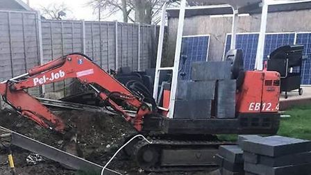 The digger, which was stolen from a front garden in Glebe Crescent, Cawston, Norfolk, on March 28. P