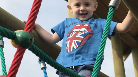 Braving the rope bridge at the new £100,000 outdoor play area at Stomp, Dine, Strike in North Walsha