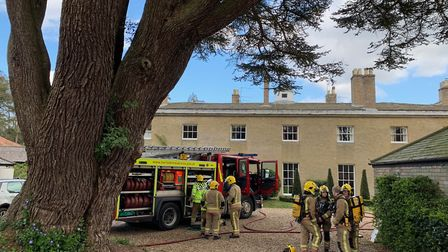 Firefighters outside Gunton Hall in north Norfolk, where a fire broke out on April 11, 2019. Picture