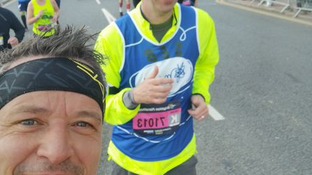 Mearl Brown, left, and Sebastian Gasse, right, running the Brighton Marathon for Mind. Photo: Mearl
