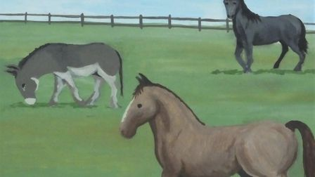 Horses in West Runton, depicted on the village sign. Picture: DR ANDREW TULLETT