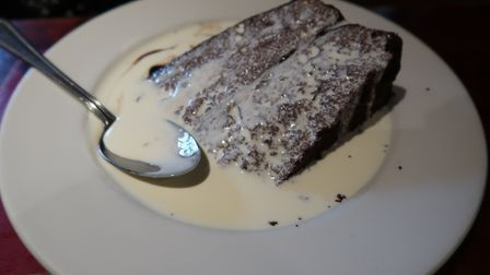 The American chocolate fudge cake, served with cream, (£4.50) at the New Forge in Aylsham. Picture: