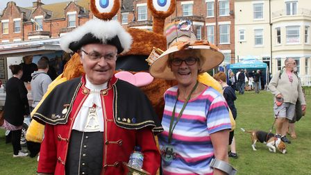 Cromer town crier Jason Bell with Crab and Lobster festival president Hilary Cox pose for a photo wi