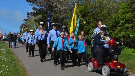 Group of the year winners Hoveton and Wroxham Scout Group on the march at the annual St George's Day