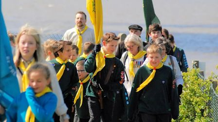 Roughton Cubs and Beavers march along the clifftops for a service at Beeston Hall School.Picture: AN