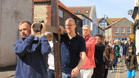 Sheringham Good Friday Walk of Witness: carrying the cross through the town centre.Picture: KAREN BE