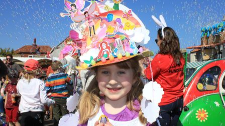 Sheringham Easter bonnet parade first prize winner Poppy Brennan, 6, with her fairy and unicorn-them