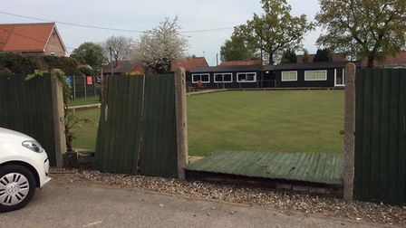Team captain Ronnie Roshier discovered the damage to the bowls club fence on Tuesday, April 23. Phot