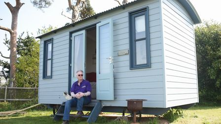 Owner Clive Meeks with one of the shepherd's huts at the Top Farm camping and glamping site at Marsh
