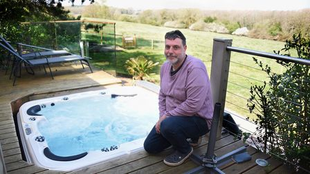 Paul Inch, owner, at the Stiltz holiday home designed as a couple's retreat at the Top Farm camping