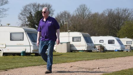Owner Clive Meeks by the caravans kept at the Top Farm camping and glamping site at Marsham. Picture