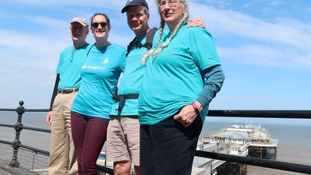 Laurence Carter, second from right, is walking round England and Wales to raise awareness of cervica