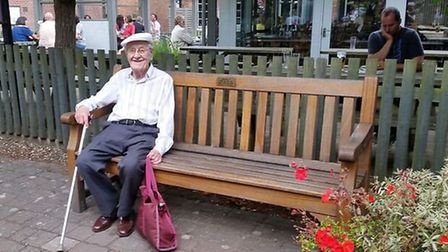 Peter Mills on the bench in Apple Yard, Holt that he donated in memory of his wife and three step-ch