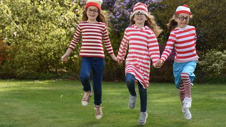 Wally's from left, twins Aggie and Bea Chuter, seven; and Ilona MacNicol, six; at the Where's Wally