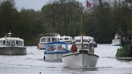 The flotilla is led by organiser Chris Moffatt, in the small open boat, from Hoveton to Horning to t