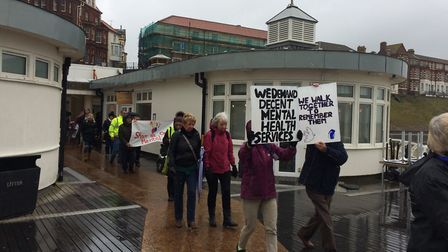 Campaigners at Cromer Pier protesting the lack of mental health services in north Norfolik. Picture: