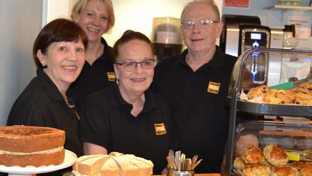 Staff behind the counter of Sheringham Little Theatre's Hub cafe and bar, which is supported by a sm