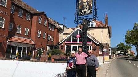 Manager Ken Fotis, centre, with his parents Michael and Elaine, outside the Royal Hotel in Mundesley