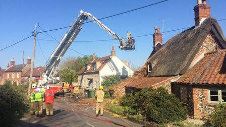 Firefighters at the scene of the blaze in Thornage. Picture: DAVID BALE