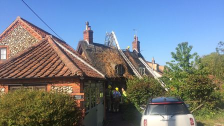 The aftermath of the blaze at a thatched cottage in Thonage, near Holt, north Norfolk. Picture: DAVI
