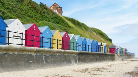 Coulourful beach huts at Mundelsey beach, one of north Norfolk's six Blue Flag beaches. Picture: LES