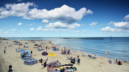 People enjoying Sea Palling beach, one of north Norfolk's six Blue Flag beaches. Picture : ANTONY KE